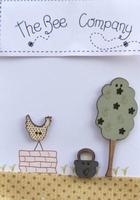 Boutons Une Poule sur un mur Bee Cie TB10D